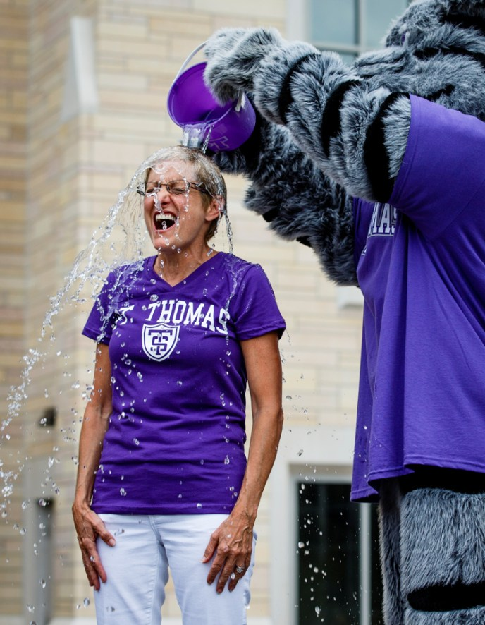 """Tommie the Mascot pours ice water on President Julie Sullivan to kick off UST's mass """"ALS Ice Bucket Challenge"""" (Photo by Mike Ekern '02)"""