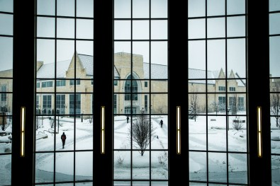 The Anderson Athletic and Recreation Complex is seen through the glass curtain wall of the Anderson Student Center.