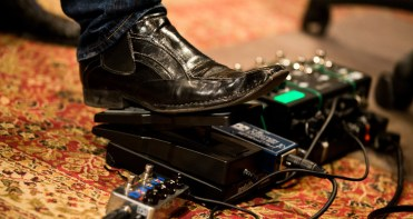 Instructor Pat Balder operates a guitar pedal during a music business class at Essential Sessions music studio in St. Paul.