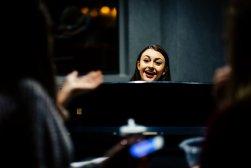 Natalie Gaskins plays piano.