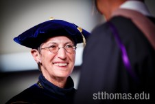 Opus College of Business Dean Stefanie Lenway smiles while handing out diplomas during the graduate business commencement ceremony May 23, 2015 in the Anderson Athletic and Recreation Complex Field House.