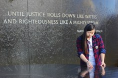Qunimill Lei reads from the Maya Lin-designed Civil Rights Memorial, Montgomery, Alabama. Photo by Kathryn Hubly.