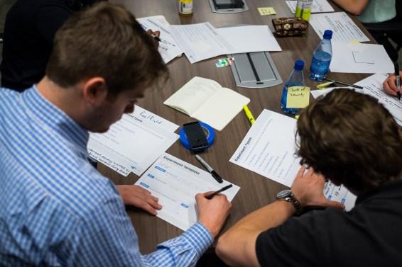 Teams work on their experiments.