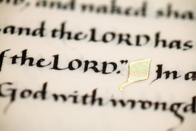 A detail of words and gold leaf in the Saint John's Bible Heritage Edition.