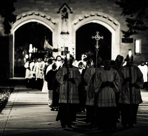 A procession of seminarians passes through The Arches for Borromeo Weekend.