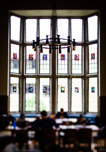 Windows in the library tower over students.