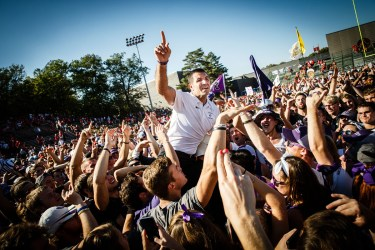 Students hoist football head coach Glenn Caruso onto their shoulders following a Tommie-Johnnie victory.
