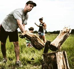 Sam Schultz splits wood.