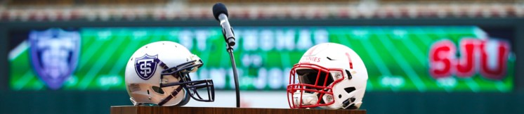 St. Thomas and Saint John's football helmets decorated the podium during today's announcement that the celebrated rivalry would be played at Target Field in 2017.