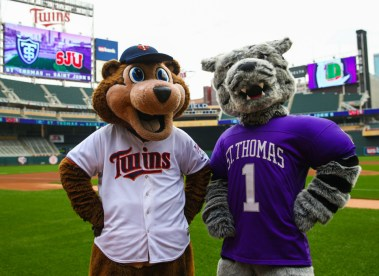 Tommie and T.C. Bear pose for a photo at Target Field.