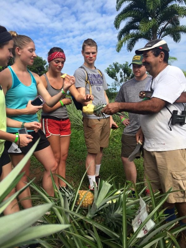 "First place, Global Classroom: Nick Hable, Costa Rica. ""Our Costa Rican Guide Rudy: This photo was taken at an organic pineapple farm in Costa Rica next to one of the world's leading biological stations, La Selva. This farm is unique because it does not use any pesticides or chemicals, which helps protect and sustain the environment. The people in this photo from left to right are Madison Gonsior, Emma Squires-Sperling, Mckenna Reid, Nick Hable, Ethan Ridgewell and our local guide Rudy."""
