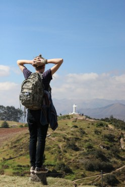 """Honorable mention, Tommies Abroad: Erin Kern, Cusco Peru. """"PERUsing the Landscape: Student Zach Beckman observes the landscape outside of Cusco, Peru, atop the Saksaywaman citadel built by the Incas."""""""
