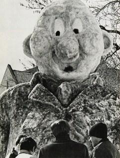 A snow sculpture looms over onlookers in 1970.