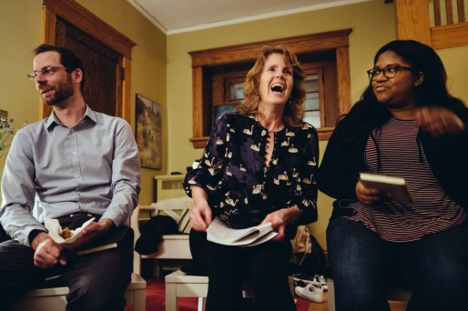 The first book discussion group was held in professor Julie Oseid's home. Here, she shares a laugh with her discussion co-leader, Kay Bolanos, a first-year student, while Scott Fulks, another student discussion leader looks on.