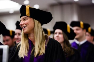 A School of Law student laughs during the School of Law Commencement ceremony May 13, 2017 at the Minneapolis Hilton.