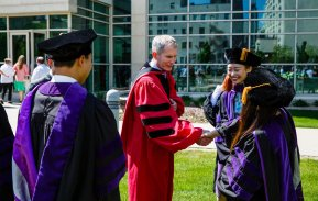 School of Law dean Robert Vischer greets new graduates following the School of Law Commencement ceremony May 13, 2017 at the School of Law.