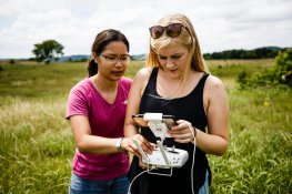 Rinn (left) and Ready check the status of the drone as it runs an automated route.