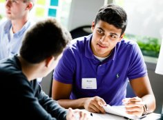 Students, including Rohail Raza brainstorm together.