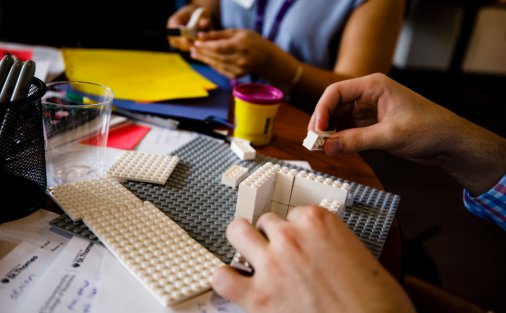 Students use Legos to build prototypes.