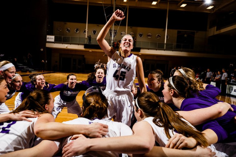 Kaitlin Langer and the the women's basketball team psych up before a game against Bethel University January 4, 2017 in Schoenecker Arena. The Tommies beat the Knights 71-62