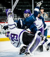Goalie Benjamin Myers absorbs a hit after making a save.