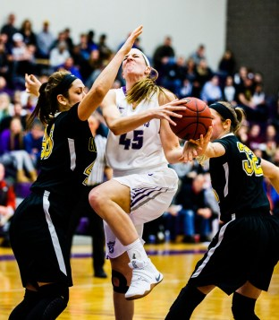 Kaitlin Langer puts up a shot during the women's basketball MIAC Championship game in February.