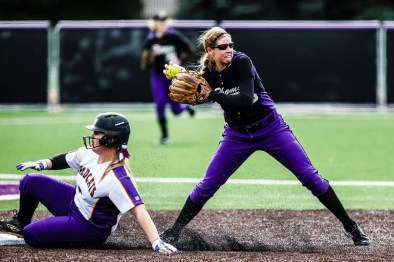 Rachel Suter throws for a double play.