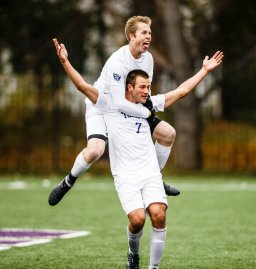 Christian Elliehausen celebrates a goal with teammate Pierce Erickson on his back during the MIAC Championship soccer game against Macalester on the south athletic fields on November 4, 2017 in St. Paul.