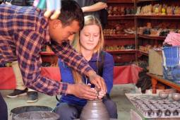 """Third place, Global Classroom: Bryjett Nordmark, Bhaktapur, Nepal. """"The Potter and The Clay: A local potter helps me form a clay cup in Potter's Square. He is helping shape the clay into a work of art and helping shape the mind to open up to new ways of thinking during an experience one can only have by studying abroad."""""""