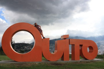 "First place, Tommies Abroad: Tayler Sartin, Quito, Ecuador. ""Quito: This is one of the many Quito signs in El Parque Itchimbia with El Panecillo in the background. El Parque Itchimbia is situated atop a mountain, so it offers a great view of the dense city that appears to extend and wind through the mountains forever. There are also great views of the historic city center, the valley, and the mountain ranges that surround the city."""