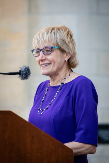 President Julie Sullivan speaks at the kickoff to the 2018 March Through the Arches ceremony for graduating seniors on May 18, 2018 in St. Paul.