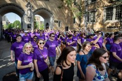 Seniors walk under the Arches during the 2018 March Through the Arches ceremony for graduating seniors on May 18, 2018 in St. Paul.