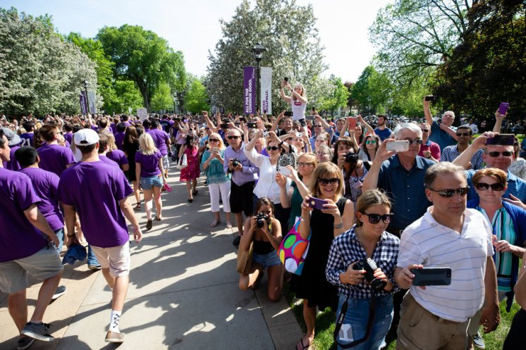 Family, staff and faculty celebrate with seniors during the 2018 March Through the Arches ceremony for graduating seniors on May 18, 2018 in St. Paul.