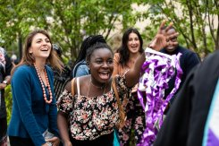 Friends and family of a graduate toss confetti streamers as they celebrate with a graduate after the 2018 Graduate Commencement ceremony on the St. Paul campus on May 18, 2018 in St. Paul.