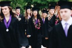 St. Thomas graduates walk toward O'Shaughnessy Stadium for commencement.