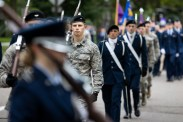 Members of St. Thomas' ROTC detachment march during the Homecoming parade.