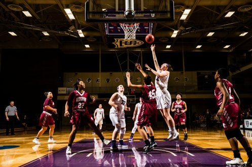Hannah Spaulding shoots over a defender during a women's basketball game against Augsburg University on February 7, 2018 in Schoenecker Arena in St. Paul. The Tommies won the game in overtime by a final score of 70-66.