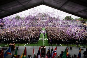 Confetti flies at the end of the 2018 Undergraduate Commencement ceremony in O'Shaughnessy Stadium on May 18, 2018 in St. Paul.