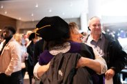 A graduating student receives a hug after the 2019 School of Law Commencement Ceremony at Westminster Presbyterian Church in Minneapolis on May 18, 2019.
