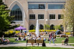 Students enjoy a sunny day on the lower quad, as seen on May 15, 2019 on the St. Paul campus.