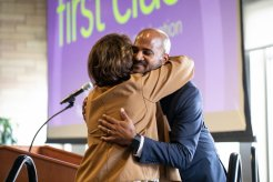 Alvin Abraham hugs Kathy Dougherty during a Dougherty Family College reception for faculty, staff, students and donors in honor of the first graduating class in Woulfe Alumni Hall on May 16, 2019, in St. Paul.