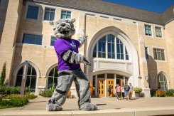 Tommie dances in front of the Anderson Student Center as students and families arrive on campus.