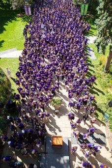 Incoming first-year students March Through the Arches.