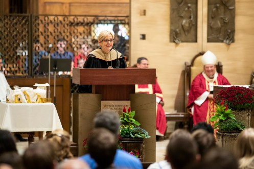 University president Julie Sullivan speaks during the Opening Mass Sept. 5, 2019 in the newly renovated interior of the Chapel of St. Thomas Aquinas.