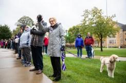 President Julie Sullivan waves during the homecoming parade. (Liam Doyle/University of St. Thomas.)