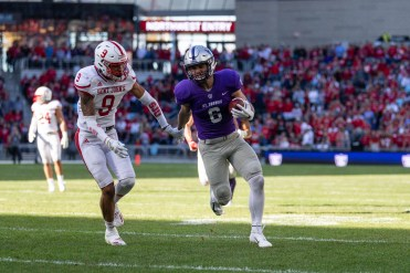 A St. Thomas player breaks loose from a would-be St. John's tackler.