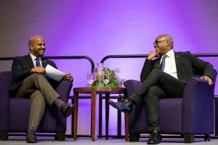 Alvin Abraham, left, dean of the Dougherty Family College, and Greg Cunningham, VP and head of diversity and inclusion at U.S. Bank, have a fireside chat style discussion during the First Friday Speaker Series. Liam James Doyle/University of St. Thomas