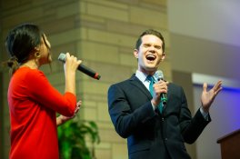 Danielle Wong and KSTP anchor Matt Belanger perform a duet at the ThreeSixty Journalism Great MN Media Get-Together in Woulfe Alumni Hall. Mark Brown/University of St. Thomas