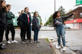 """Student Tiaryn Daniels speaks during an Art History class on October 10, 2019, in St. Paul. The class was discussing the mural """"Braided,"""" part of the Midway Murals project in the Midway Neighborhood. Mark Brown/University of St. Thomas"""