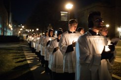 Seminarians process across the lower quad following a mass in the Chapel of St. Thomas Aquinas during the Borromeo Weekend Procession. Liam Doyle/University of St. Thomas